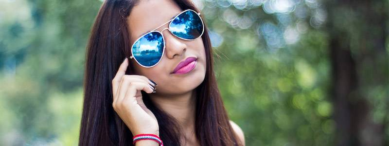 Girl Wearing Blue Tinted Sunglasses 800×300
